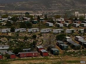 U.S. President Barack Obama has called for a freeze on all building in Israeli settlements in the West Bank.