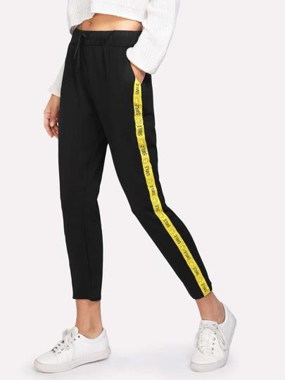 Pantalones de lado con cinta en contraste