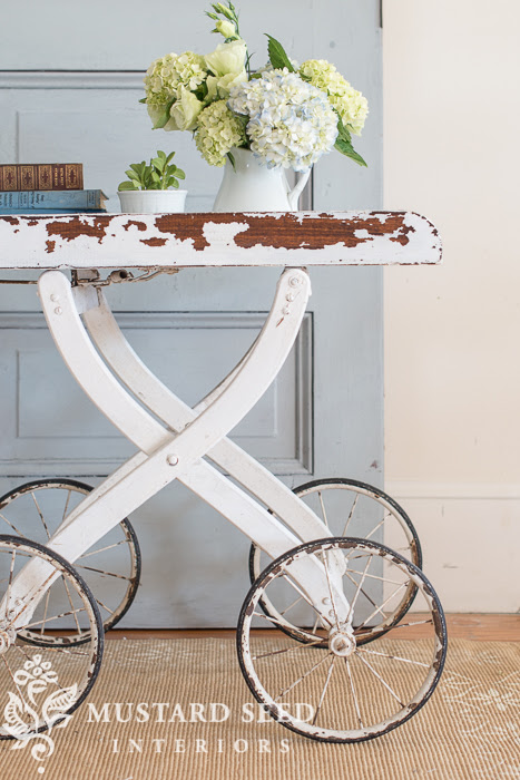 Vintage Pram repurposed into a stylish and unique table by Miss Mustard Seed.  |  Friday Favorites at www.andersonandgrant.com