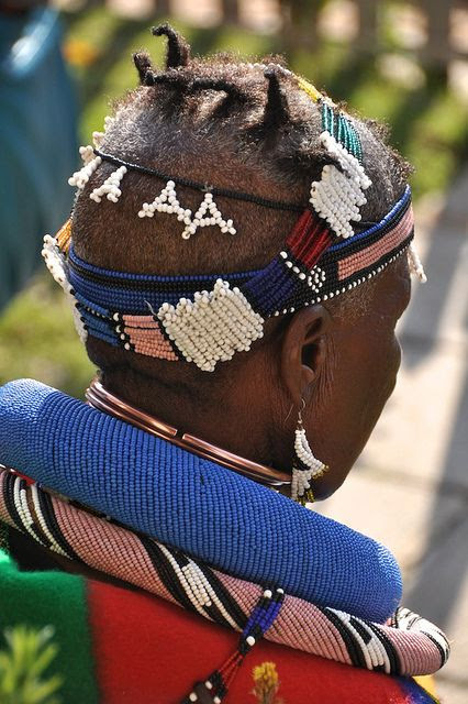 Africa | The traditional adornments and hairstyle of Esther Mahlangu at the ATASA Trust Southern Africa Handcraft & Ndebele Art Exhibition opening, June 2010, Newtown South Africa | ©Lauren Barkume