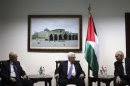 Palestinian President Abbas meets with Arab League Secretary-General Elaraby and Egyptian FM Amr upon their arrival in Ramallah