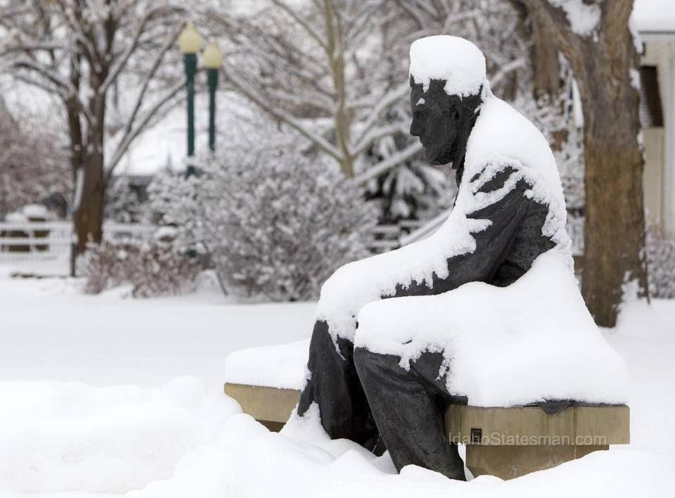 Snow covers a statue of Abraham Lincoln in Boise's Julia Davis Park Thursday Jan. 5, 2017.