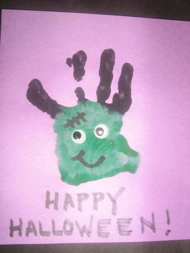 A fun Halloween hand print art project from a KinderCare toddler. #HappyHalloween #decor #decoration #HalloweenParty #pumpkin #simple #party #kids #children #preschool #kindergarten #toddler #prek #diy #craft #art #activity via #KinderCare