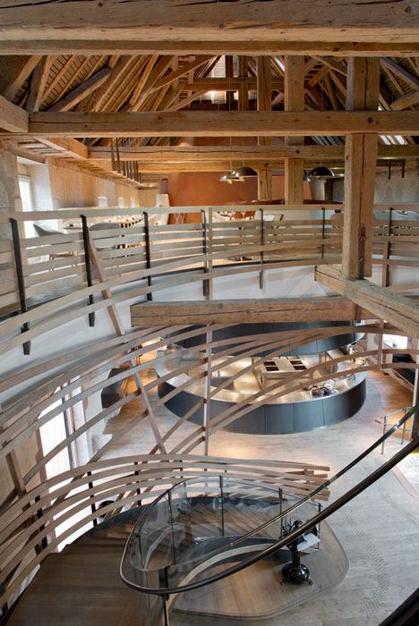 Wooden strips coil around staircase at Strasbourg restaurant