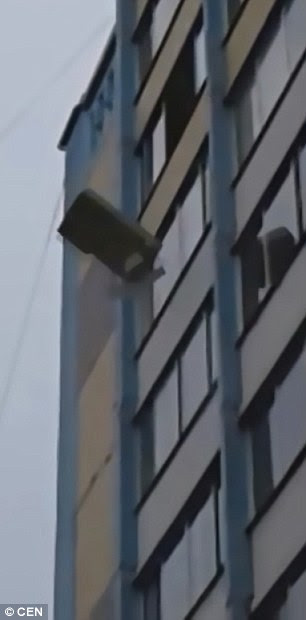 A furious boyfriend hurled the entire contents of his flat - including a sofa and a washing machine - out of the window in Chelyabinsk, central Russia
