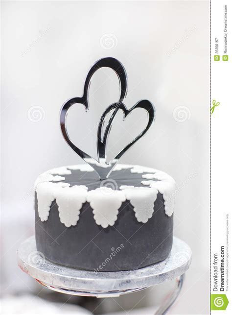 Wedding Cake In Black And White With Heart Decoration