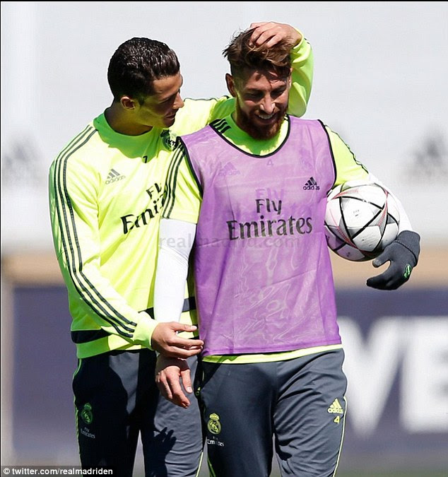 Ronaldo (left) chats to Sergio Ramos as the Real Madrid prepare for the match against Manchester City