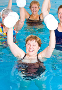 photo of women exercising in a swimming pool