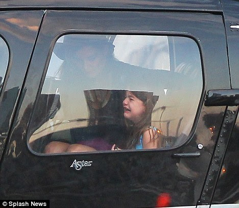 Upset: Suri, five, was left devastated as she and her mother sat in the helicopter but the little girl was without her favourite blanket