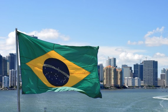 A view of the Brickell skyline from 2009 (Credit: creative commons user MiamiTom) and the flag of Brazil (Credit: Max Hendel)