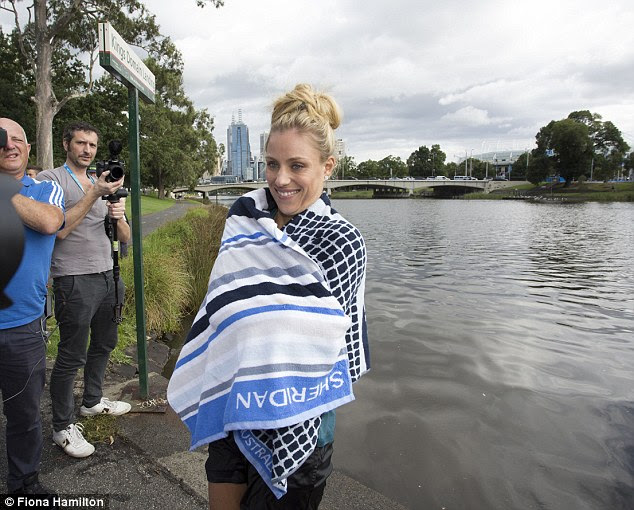 The tennis star didn't put her head under- her top knot as dry after her swim as it was before
