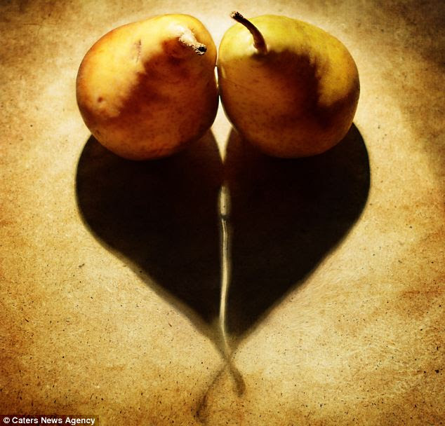 Pear-fect: The well-placed pears cast a shadow in the shape of a heart