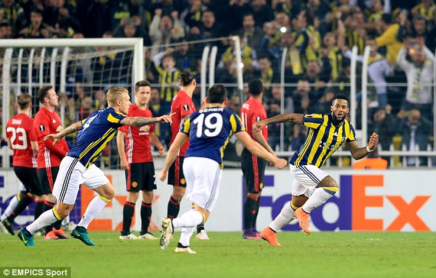 Jeremain Lens (right) wheels away after doubling his side's lead with a curling free-kick