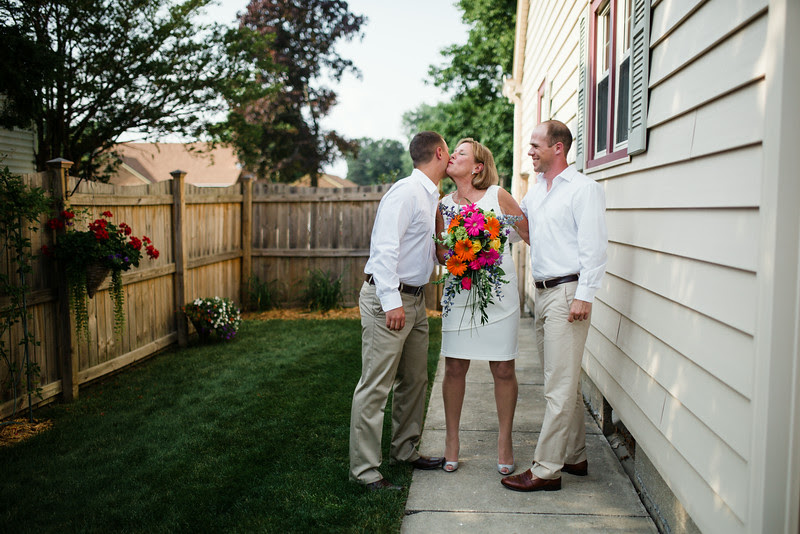 An intimate backyard wedding ceremony in Rockford IL near Sinnissippi with close friends and family.
