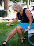 Woman applying insect repellent to her own leg