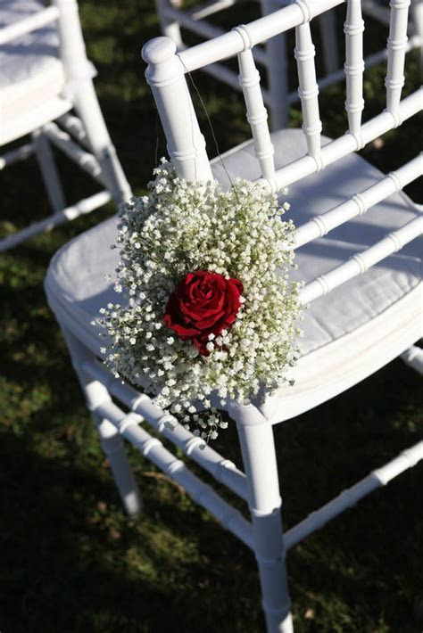 Guests chairs with white gypsophila and Maranello red rose