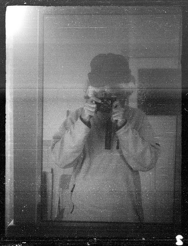 reflected self-portrait with Nagel Vollenda camera and wooly hat by pho-Tony