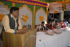 Vibhuti Narain Rai addressing a gathering in the library established by him in his village