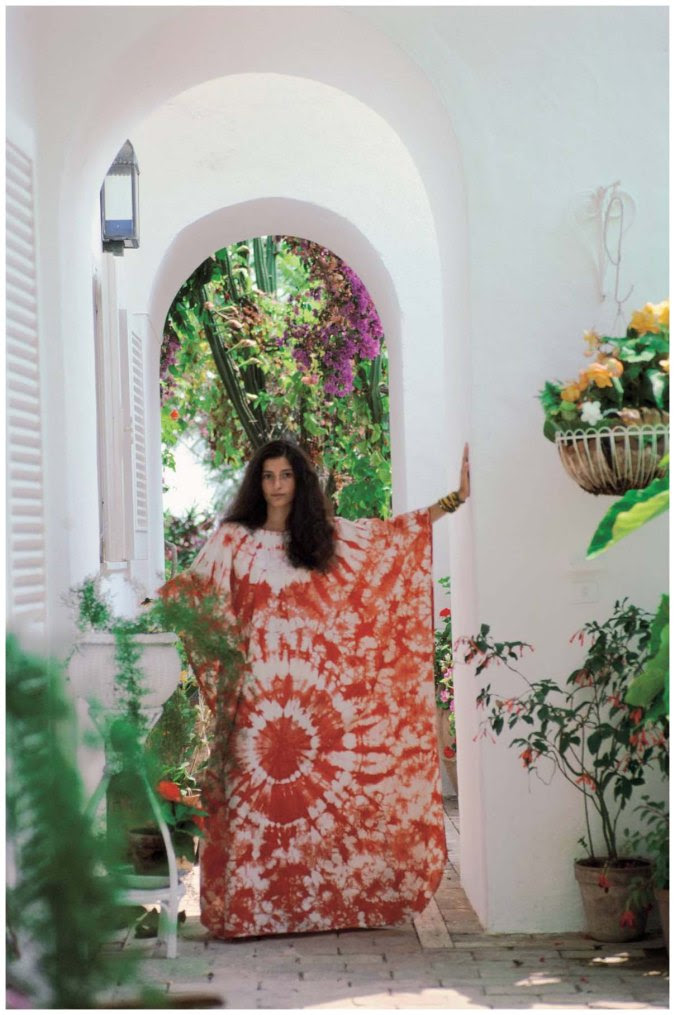 Norina Pisciotto in an African dress her uncle gave her as a birthday present