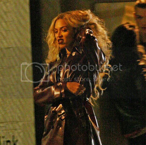 Snapshot: Beyoncé struts around in red leather trench for music video shoot...