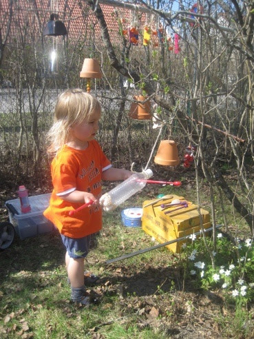 A musical tree -- another good activity for the outdoor environment -- kids can bring something from home for their contribution. Many good ideas on this website