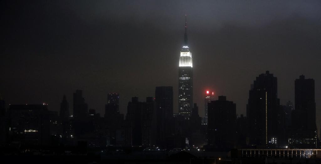 A blacked out New York City skyline is seen from Brooklyn, New York, October 29, 2012 as Hurricane Sandy made landfall in the northeastern United States.