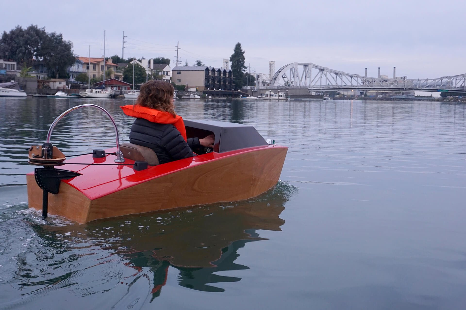 Erika riding towards the bridge at the first launch of the mini electric boat