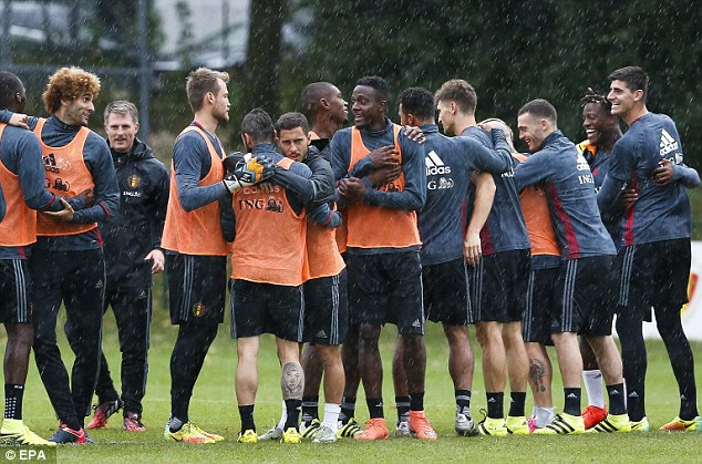 The Belgium players huddle up as train in wet weather ahead of their game in Cyprus