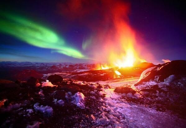 The Aurora Borealis and a volcano eruption meet in Iceland.