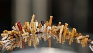 Extinguished cigarettes are seen in an ashtray at the Shanghai Railway Station