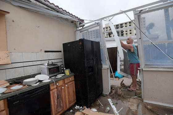 Homeowner Joe Lovece surveys the damage to the kitchen at the back of his oceanfront home after the eye of Hurricane Matthew passed Ormond Beach, Fla., Oct. 7, 2016. Lovece rode out the storm as waves took away the room at the back of his home.
