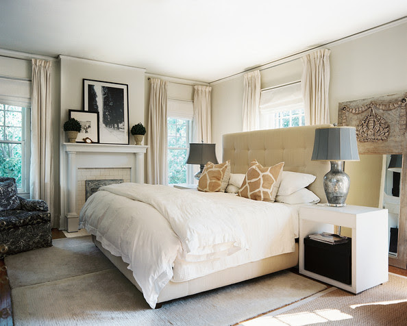 Bedroom - A tufted headboard and white bed linens in a neutral master bedroom