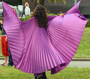 Nikki Nez twirling in purple at a God is Love ...