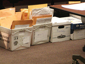 English: Boxes of challenged ballots sorted by...
