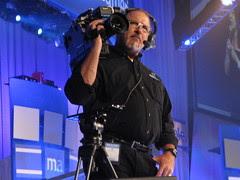 cameraman in black