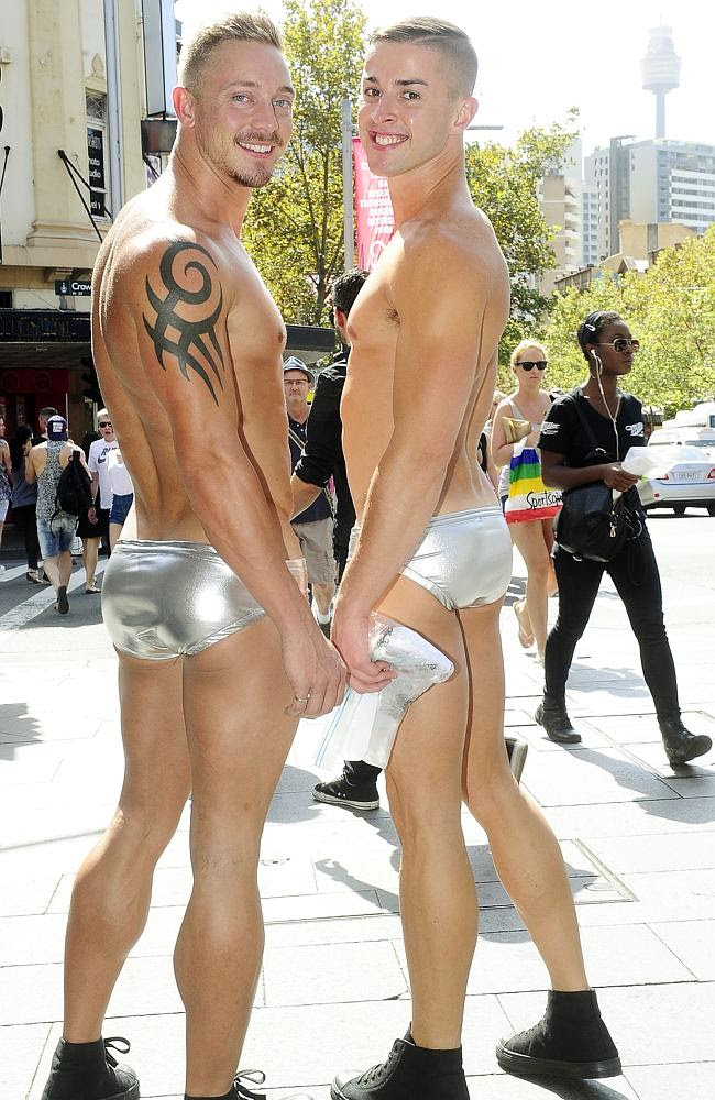 Mike Sinclair and Steven Capp make their way down Oxford St in Sydney in preparation for