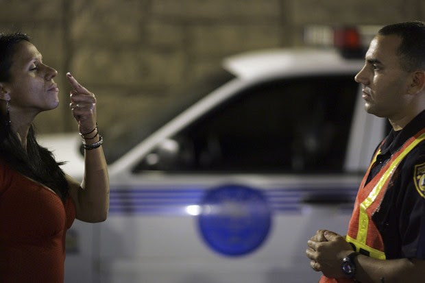 Officer Kevin Millan of the Miami Beach police department conducts a field sobriety test at a DUI checkpoint in Miami, Fla., Dec. 15, 2006.