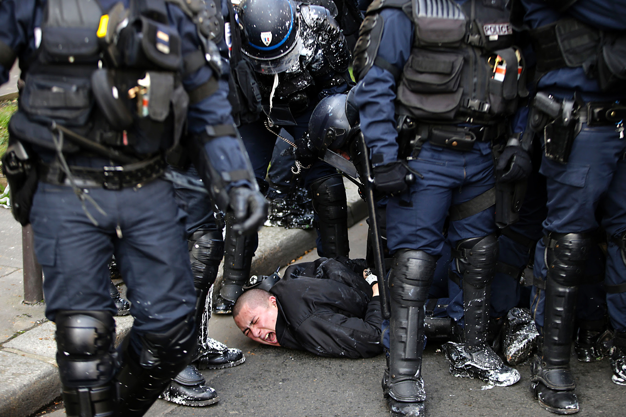 Anti-riot police officers arrest a man d...Anti-riot police officers arrest a man during clashes within a demonstration of high school students protesting against the government's planned labour reform, on April 5, 2016 in eastern Paris.  The Socialist government is desperate to push through reforms to France's controversial labour laws, billed as a last-gasp attempt to boost the flailing economy before next year's presidential election.  / AFP PHOTO / KENZO TRIBOUILLARDKENZO TRIBOUILLARD/AFP/Getty Images