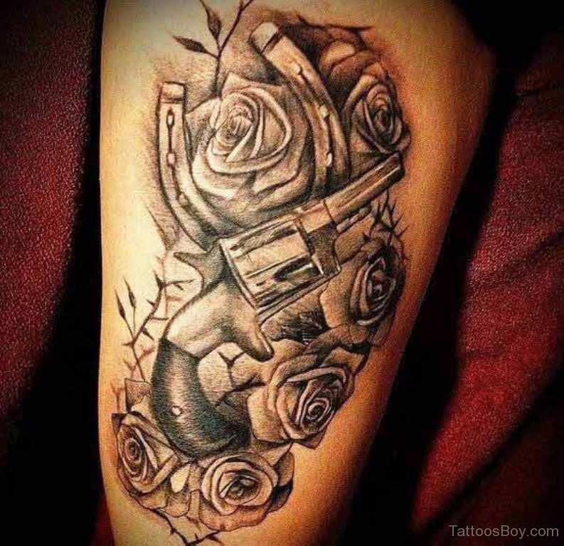 Gun And Rose Tattoo On Thigh Tattoo Designs Tattoo Pictures