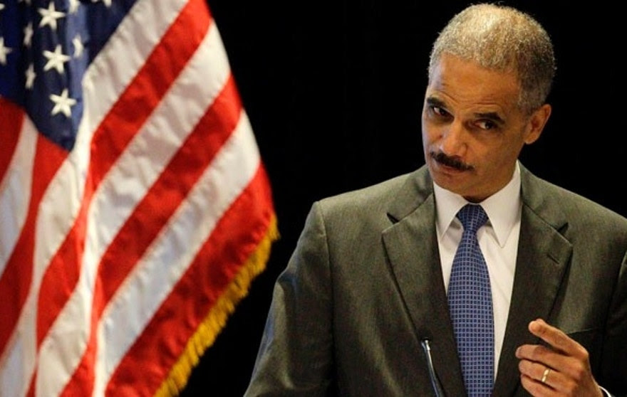 "U.S. Attorney General Eric Holder gestures while speaking at the ""Protecting Civil Rights: A Symposium on Key Civil Rights Issues"" in Boston, Tuesday, June 26, 2012. With a vote looming to hold Holder in contempt of Congress, a House committee chairman is challenging President Barack Obama's claim of executive privilege, invoked to maintain secrecy for some documents related to a failed gun-tracking operation.  (AP Photo/Stephan Savoia)"