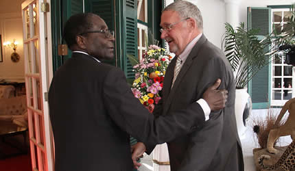 Zambian Vice-President Guy Scott welcomed to Zimbabwe by President Robert Mugabe. They discussed a grain deal between the two Southern African states. by Pan-African News Wire File Photos