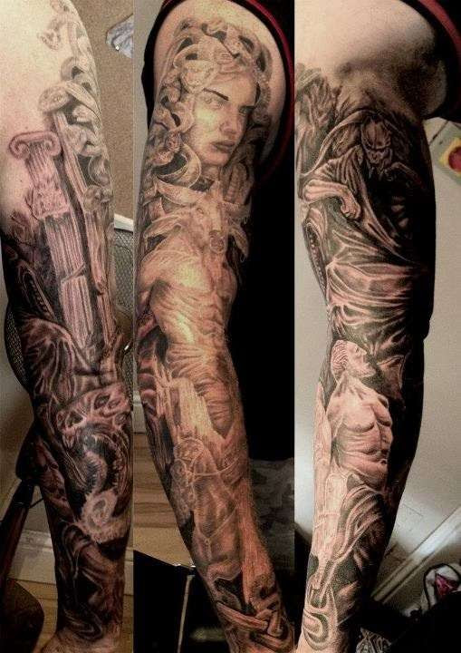 Red Ink Greek Tattoo On Sleeve