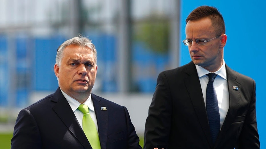Hungarian Prime Minister Viktor Orban, left, and Foreign Minister Peter Szijjártó have led the government's hardline stance on illegal immigration.