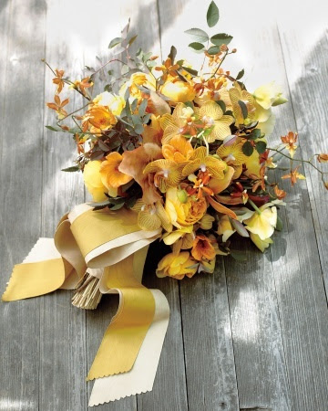 Yellow Phalaenopsis and Miltonia and orange Oncidium orchids have the same effortless appeal as wildflowers