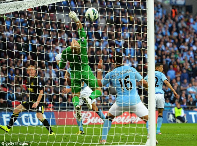 Despairing: Joe Hart couldn't keep Watson's header out as Wigan won their first ever major trophy