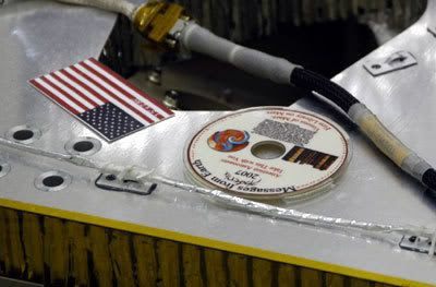 The Phoenix DVD, which bears the names of 250,000 people, after it is attached to the deck of the lander.