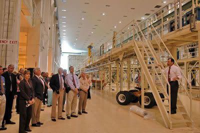 NASA officials take a tour of the Operations and Checkout Building at Florida's Kennedy Space Center.  The OCB will be the facility where the ORION spacecraft is assembled and tested before flight.