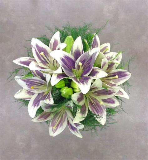 Purple and white lily bridal bouquet by Nancy at Belton