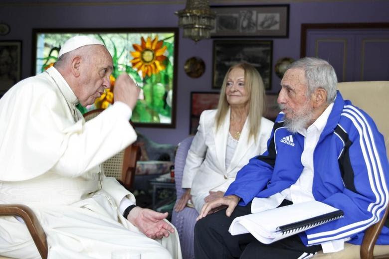 Pope Francis (L) talks with former Cuban President Fidel Castro (R) as Castro's wife Dalia Soto del Valle looks on in Havana, Cuba, September 20, 2015. REUTERS/Alex Castro/AIN/Handout via Reuters