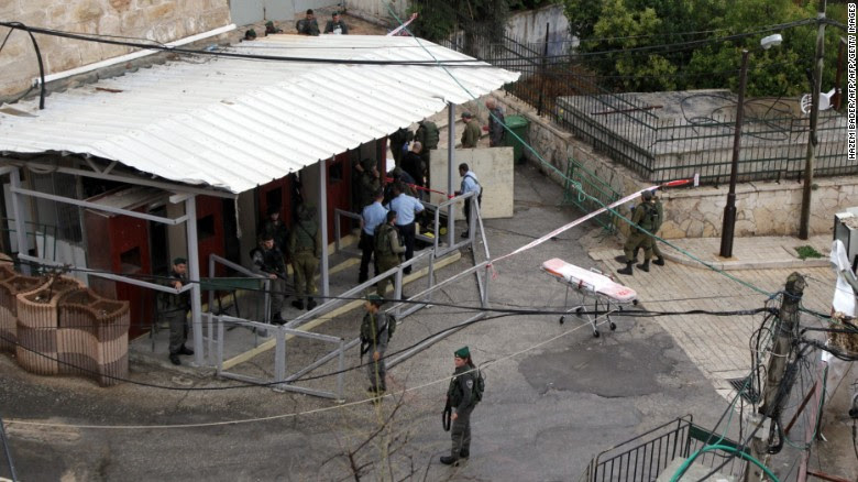Israeli police said a Palestinian woman was shot after approaching border police with a knife.